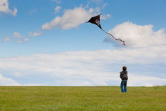 The little boy with a kite. Little boy with a kite on the blue sky and meadow Stock Images