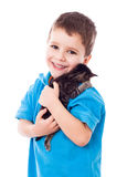 Little boy with kitty in hands Stock Photo