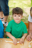 Little boy knead dough. Outdoor activity, education Stock Images