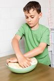 Little boy kneading Stock Photo