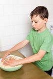 Little boy kneading Stock Photography