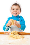 Little boy kneading for Christmas cooking Stock Photo