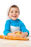 Little boy kneading for Christmas cooking Stock Images