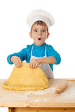 Little boy kneading the dough Stock Photography