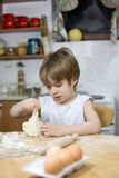 Little Boy Kneading Dough, Trying to Become an Excellent Baker Stock Image
