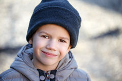 Little boy in knit cap at winter. Smile, outdoor portrait Royalty Free Stock Images