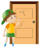Little boy knocking on the door Royalty Free Stock Photography