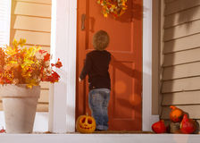 Little Boy Knocking On The Door Stock Photography