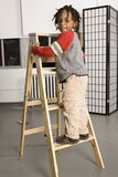 Little boy on a ladder Stock Photography