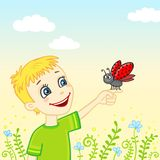 Little boy with a ladybug on a palm Stock Photography