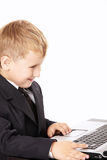 Little boy and the laptop Stock Images