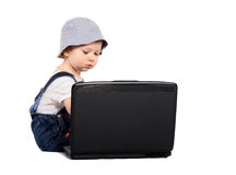 Little boy with a laptop. Little boy sitting with a laptop isolated on the white Stock Photography