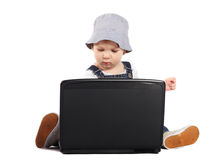 Little boy with a laptop. Little boy sitting with a laptop isolated on the white Royalty Free Stock Image