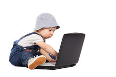 Little boy with a laptop. Little boy sitting with a laptop isolated on the white stock photos