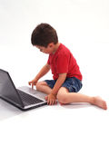 Little Boy and Laptop. Hispanic little boy looking at a laptop Stock Photography
