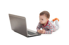 Little boy and laptop isolated Stock Photos