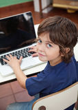 Little Boy With Laptop In Preschool Stock Photography