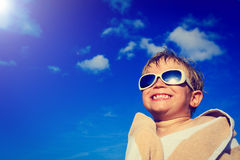 Little boy laugh wrapped in beach towel on sky Stock Images