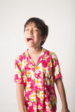Little boy laughing portrait standing angry face Stock Photo