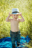 Little boy on the lawn, a child for a walk outdoors Royalty Free Stock Photography