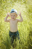 Little boy on the lawn, a child for a walk outdoors Stock Photo