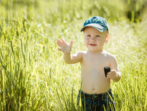 Little boy on the lawn, Royalty Free Stock Photography
