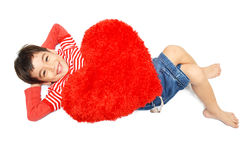 Little boy lay down with pillow heart Stock Photos