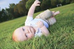 Little boy lay Stock Photography