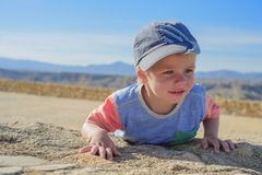 Little boy laying down on the rock Royalty Free Stock Photo