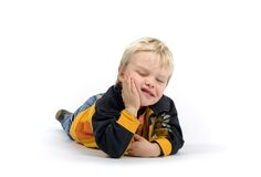 Little Boy Laying On Floor Stock Photo