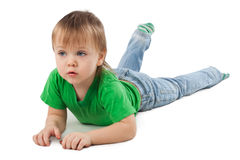 Little boy laying on the floor. Isolated on white Stock Photo