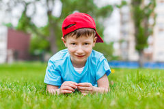 Little boy laying in the grass Royalty Free Stock Photography