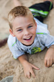 Little boy Laying on the rocks Royalty Free Stock Images