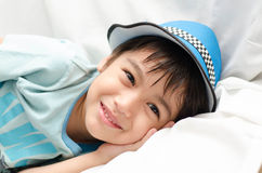 Little boy laying on sofa looking at camera royalty free stock photos