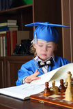 Little boy leafs through a book Stock Photos