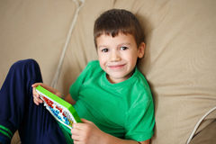Little boy learn counting on abacus Stock Images