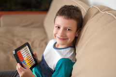Little boy learn counting on abacus Royalty Free Stock Photography