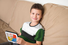 Little boy learn counting on abacus Stock Photos