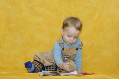 Little boy learn paint Royalty Free Stock Images