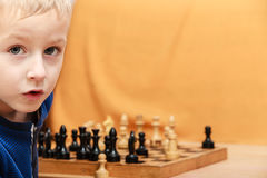 Little boy learn to play chess. Royalty Free Stock Photography