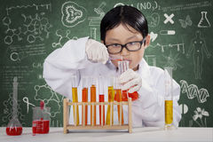 Little boy learning chemistry in the lab Royalty Free Stock Images