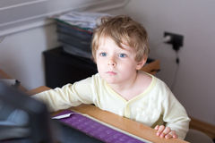 Little boy learning on computer  at home Royalty Free Stock Photography