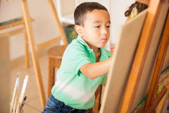 Little boy learning how to paint stock photos