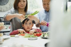 Little boy Learning how to Cook stock image