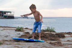 Little boy learning how to surf Stock Photo
