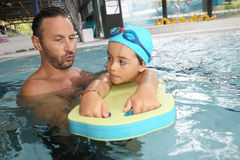 Little boy learning how to swim with monitor Stock Photo
