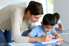 Little boy learning how to write with teacher Royalty Free Stock Photography