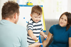 Little boy learning letters and numbers Royalty Free Stock Image