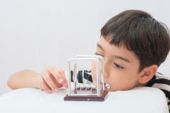 Little boy learning newton balance ball for science physic Stock Photography