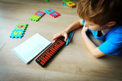 Little boy learning numbers, mental arithmetic, abacus Stock Image